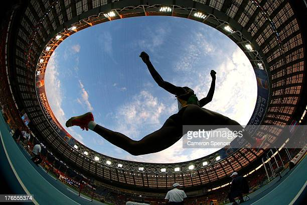 THIS IMAGE WAS CREATED WITH A FISH EYE LENS An athlete competes in the Women's Triple Jump final during Day Six of the 14th IAAF World Athletics...