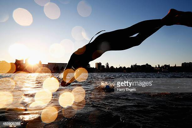 An athlete dives into the water during Ironman Vichy on August 30 2015 in Vichy France