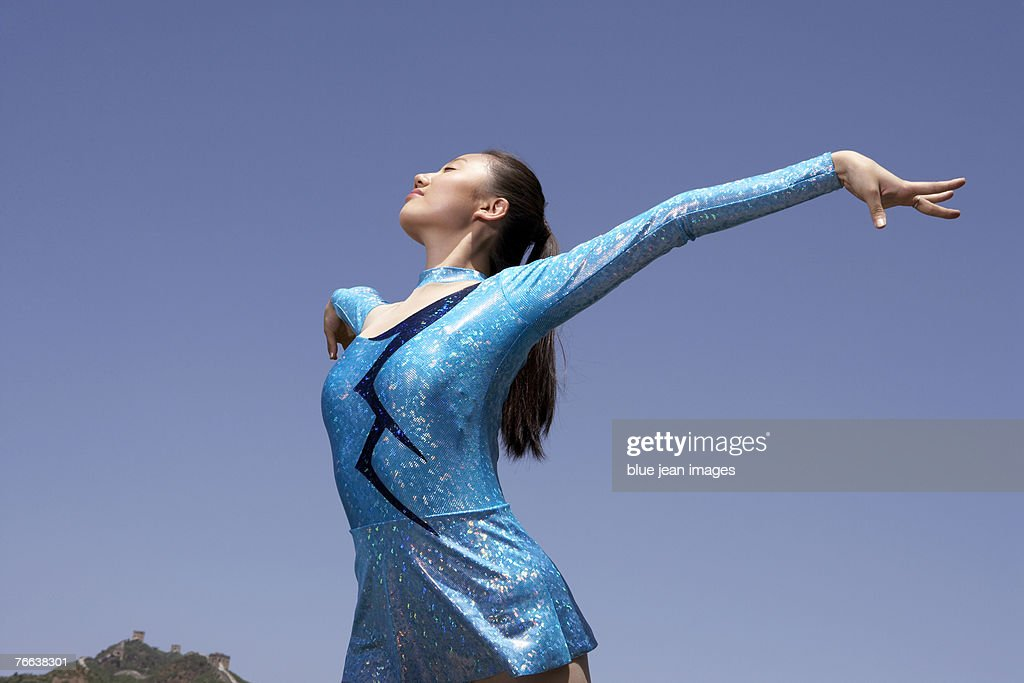 An athlete doing gymnastics on the Great Wall of China. : Stock Photo