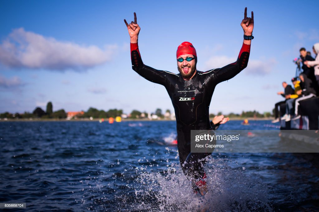 An athlete exits the water after finishing the swim leg of KMD IRONMAN Copenhagen on August 20, 2017 in Copenhagen, Denmark.