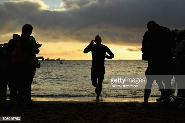 An athlete exits the water after the first lap of the swim section during Ironman Wales on September 18 2016 in Pembroke Wales