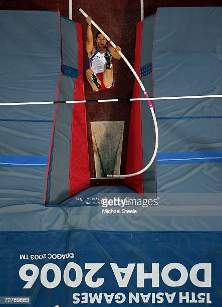 An athlete from Republic of Korea competes in the Men's pol Vault Final during the 15th Asian Games Doha 2006 at the Khalifa Stadium December 10 2006...