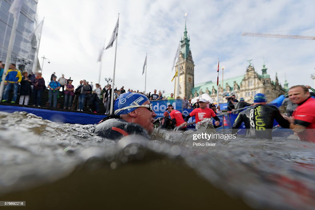 An athlete from the olympic distance swims to the swim exit in front of the town hall at the ITU World Triathlon Hamburg on July 17 2016 in Hamburg...
