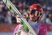 An athlete holds his skis after the K120m ski jump competition at Hakuba during the 1998 Winter Olympic games