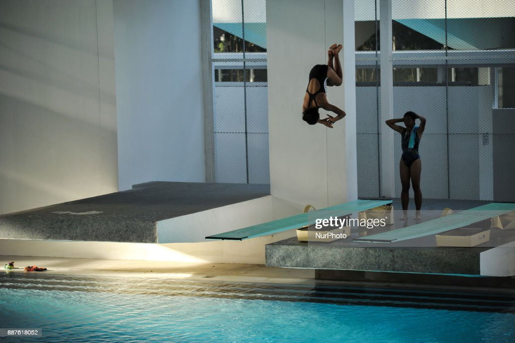 An athlete jumps as she practices before join Indonesia Open Aquatic Championship (IOAC) at the renovated Aquatics Stadium in Gelora Bung Karno sporting complex, Senayan in Jakarta, Indonesia on December 7, 2017. IOAC held from 5 to 15 December 2017 by the Board of Indonesia's Pool Association (PBRSI) as part of the test event before the 2018 Asian Games venue.