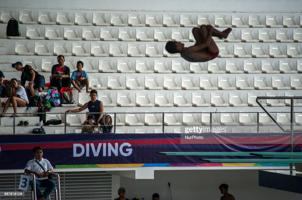 An athlete jumps in Indonesia Open Aquatic Championship (IOAC) at the renovated Aquatics Stadium in Gelora Bung Karno sporting complex, Senayan in Jakarta, Indonesia on December 7, 2017. IOAC held from 5 to 15 December 2017 by the Board of Indonesia's Pool Association (PBRSI) as part of the test event before the 2018 Asian Games venue.