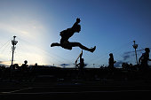 An athlete jumps over a hurdle during the Mens Under 20's 400m hurdles race during the Australian Junior Athletics Championships at Sydney Olympic...