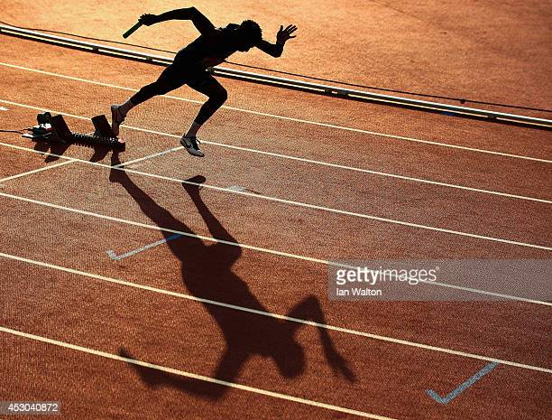 An athlete leaves the blocks at the start of the Men's 4x400 metres relay heats at Hampden Park during day nine of the Glasgow 2014 Commonwealth...