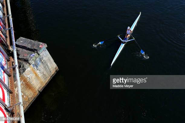 An athlete makes her way to the starting line before the Head of the Charles Regatta on October 21 2017 in Boston Massachusetts