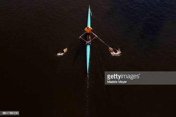 An athlete makes his way to the starting line before the Head of the Charles Regatta on October 21 2017 in Boston Massachusetts