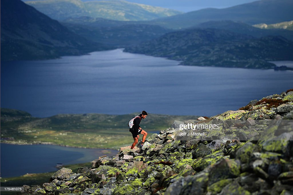 An athlete makes their way up Gaustatoppen, at 1,850m above sea level towards the finish line during the Norseman Xtreme Triathlon on August 3, 2013 in Eodfjord, Norway.The race which was first held in 2003 runs point to point and is considered among many as the ultimate triathlon in the world. Owners and organisers Hardangervidda Triathlon Club limit the number of competitors to 250 they make their way through some of Norways most beautiful scenery during the course of the race.