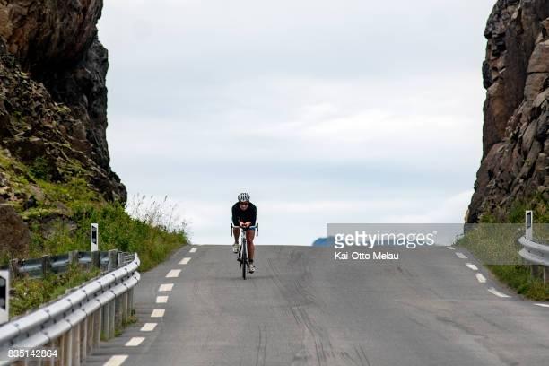 An athlete on the bikeleg at The Arctic Triple // Lofoten Triathlon Olympic distance on August 18 2017 in Svolvar Norway Lofoten Triathlon is one of...