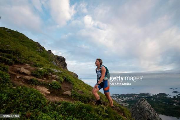 An athlete on the way up the last climb of The Arctic Triple // Lofoten Triathlon Extreme distance on August 19 2017 in Svolvar Norway Lofoten...
