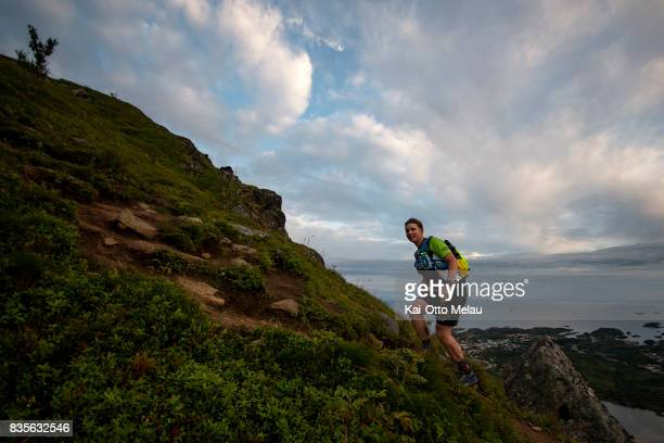 An athlete on the way up the last climb of The Arctic Triple // Lofoten Triathlon Extreme distance on August 19 2017 in Svolvar Norway Lofoten...