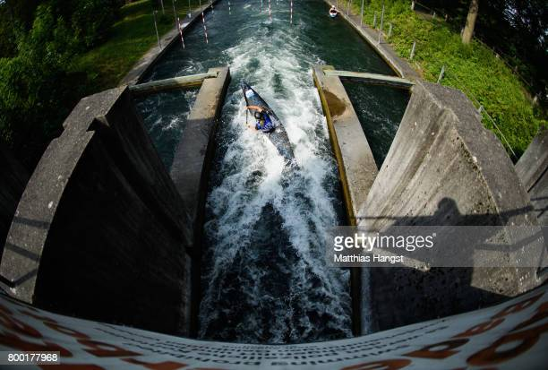An athlete passes a watergate on the way for the start during the ICF Canoe Slalom World Cup on June 23 2017 in Augsburg Germany