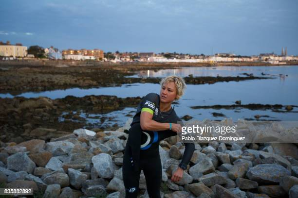 An athlete puts her wetsuit on before the start of IRONMAN 703 Dublin on August 20 2017 in Dublin Ireland