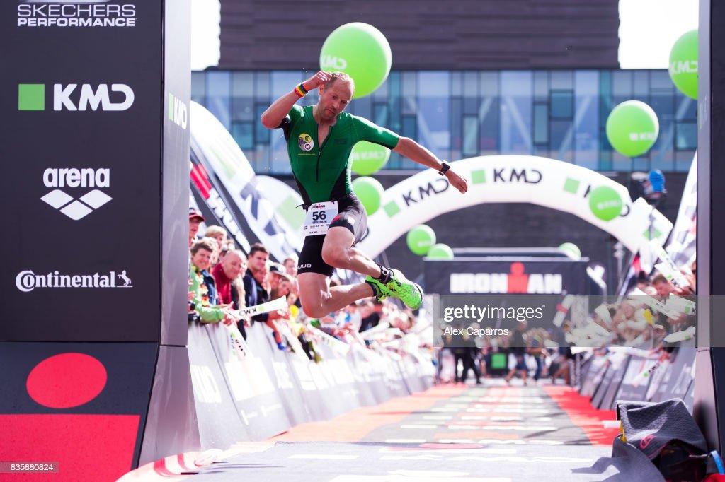An athlete reacts as he crosses the finish line of KMD IRONMAN Copenhagen on August 20, 2017 in Copenhagen, Denmark.