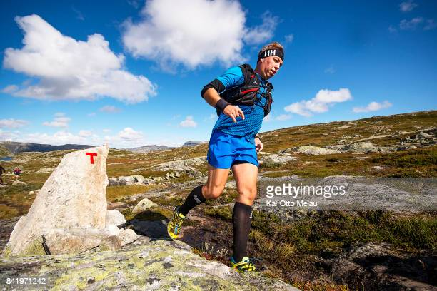 An athlete running at Hardangervidda Marathon on September 2 2017 in Eidfjord Norway Hardangervidda Marathon goes through parts of the National Park...