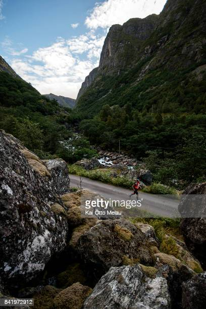 An athlete running down the Maaboe valley at Hardangervidda Marathon on September 2 2017 in Eidfjord Norway Hardangervidda Marathon goes through...