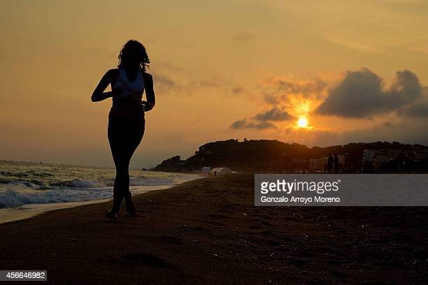 An athlete runs on the beach the day before Ironman Barcelona at Calella beach on October 4 2014 in Calella near Barcelona Spain