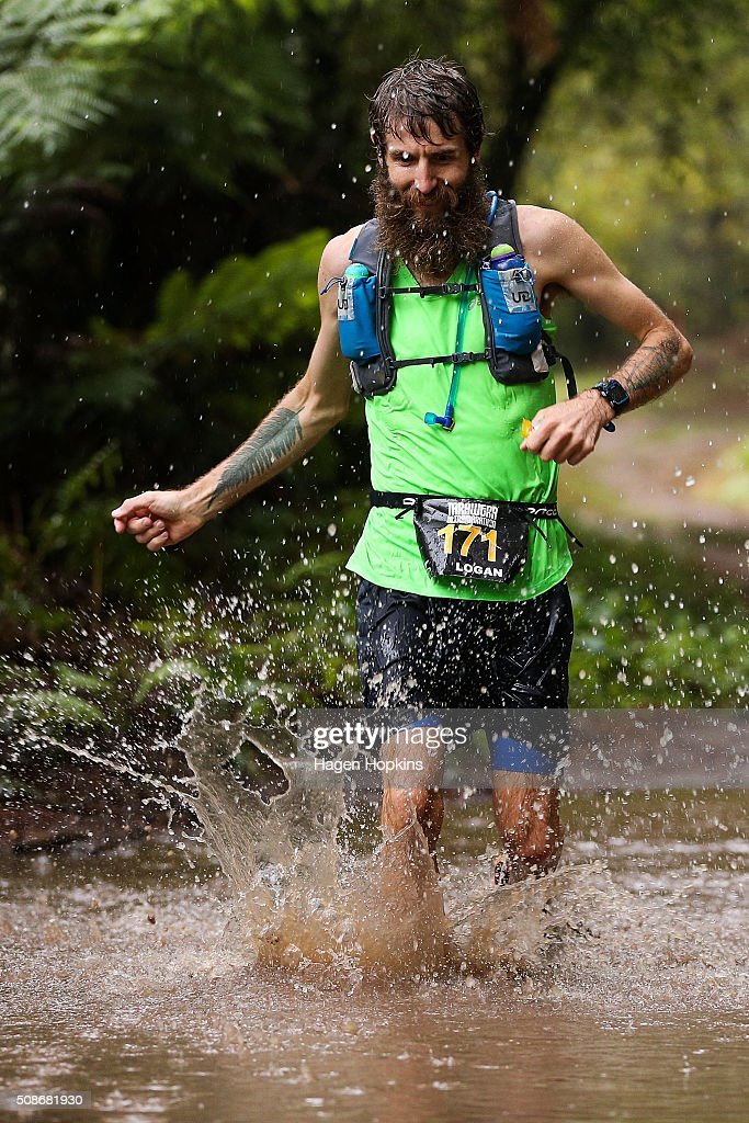 An athlete runs through water during the Tarawera Ultramarathon on February 6, 2016 in Rotorua, New Zealand.