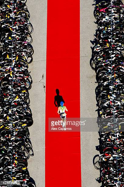 An athlete runs towards his bike after finishing the swim leg of the race during Ironman Klagenfurt on June 28 2015 in Klagenfurt Austria
