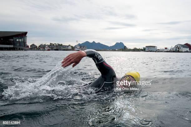 An athlete testing the water before The Arctic Triple // Lofoten Triathlon Olympic distance on August 18 2017 in Svolvar Norway Lofoten Triathlon is...