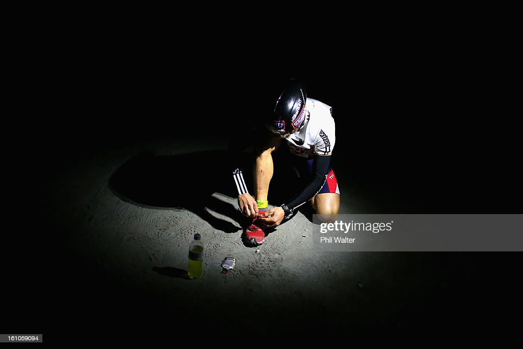 An athlete ties his laces on Kumara beach before the start of the one day individual event during the 2013 Speights Coast to Coast on February 9, 2013 in Christchurch, New Zealand.