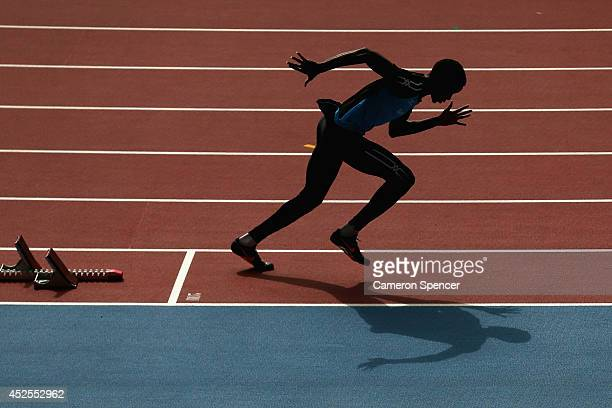 An athlete trains at Hampden Park venue for the track and field athletics ahead of the Commonwealth Games on July 23 2014 in Glasgow Scotland
