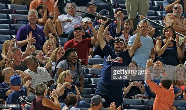 An Atlanta Braves fan catches a bat after it slipped out of the hands of Welington Castillo of the Arizona Diamondbacks during the seventh inning at...