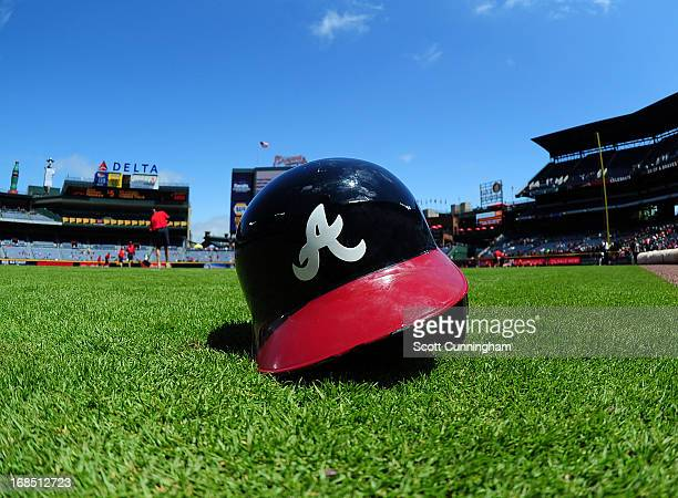 An Atlanta Braves helmet rests on the field before the game against the New York Mets at Turner Field on May 5 2013 in Atlanta Georgia