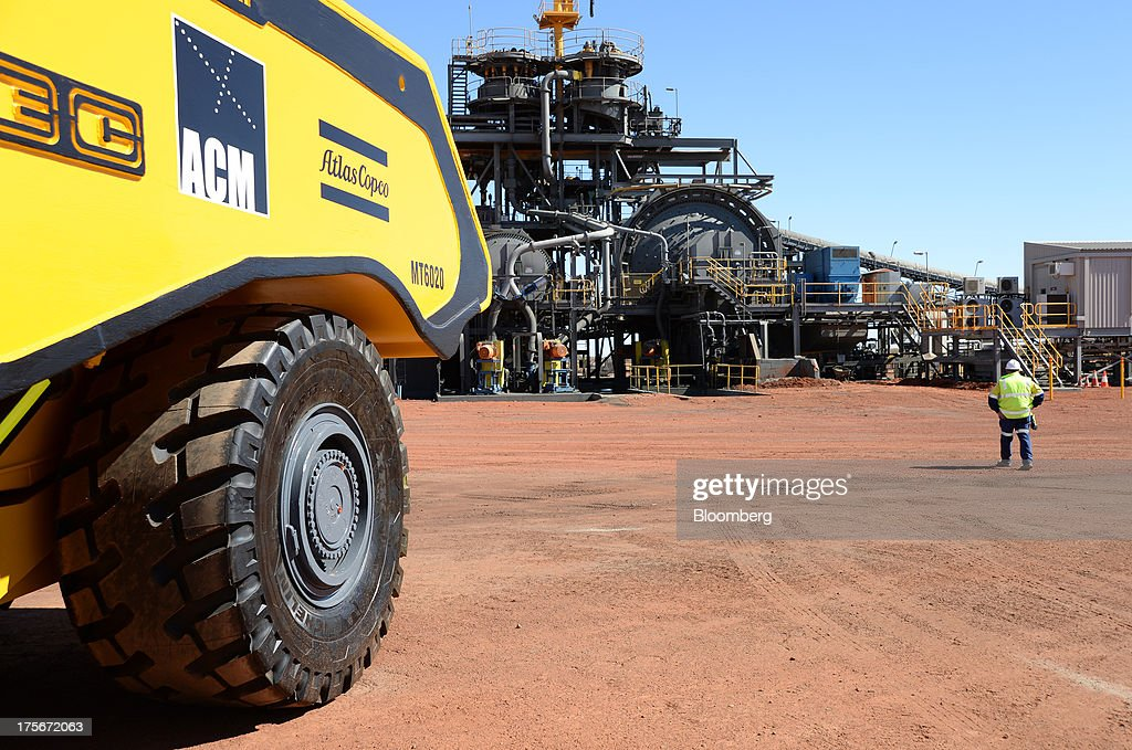 An Atlas Copco AB vehicle stands outside the processing plant at the Sandfire Resources NL copper operations at DeGrussa, 559 miles (900 kilometers) north of Perth, Australia, on Sunday, Aug. 4, 2013. Copper, used in electrical wiring and tubes, is expected to gain until at least 2015, according to analyst forecasts compiled by Bloomberg, as aging ore bodies and few large new discoveries keep the metal's supply and demand balance tight. Photographer: Carla Gottgens/Bloomberg via Getty Images