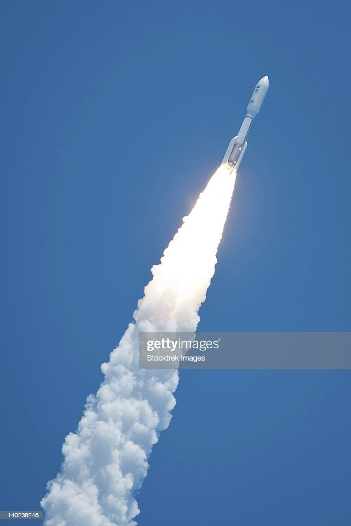An Atlast V rocket carrying the Juno spacecraft during a midday launch.