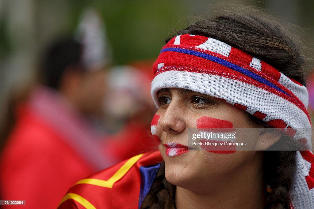 An Atletico de Madrid fan looks on outside the Barclaycard Center before the UEFA Champions League Final match between Real Madrid CF and Club Atletico de Madrid on May 28, 2016 in Madrid, Spain. Real Madrid CF and Atletico de Madrid play the final match of the UEFA Champions League in Milan.