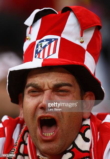 An Atletico Madrid fan cheers ahead of the UEFA Europa League final match between Atletico Madrid and Fulham at HSH Nordbank Arena on May 11 2010 in...