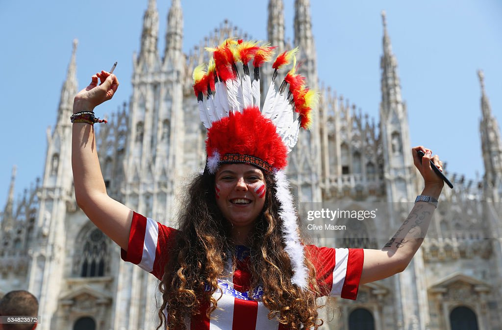 An Atletico Madrid fan enjoys the atmopshere at Piazza Duomo ahead of the UEFA Champions League Final match between Real Madrid and Club Atletico de Madrid at Stadio Giuseppe Meazza on May 28, 2016 in Milan, Italy.