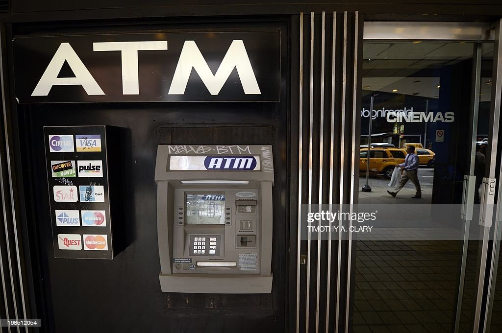 An ATM machine on Third Avenue is viewed in New York on May 10, 2013, just one of the many that were used as cyber thieves around the world stole $45 million by hacking into debit card companies, scrapping withdrawal limits and helping themselves from cash machines, US authorities said May 9, 2013. The massive heist unfolded 'in a matter of hours,' said the US prosecutor's office for Brooklyn, New York. Prosecutors unveiled charges against eight people accused of forming the New York cell of the plot, which stretched across 26 countries. In their case, they allegedly lifted $2.8 million in cash and now face charges of conspiracy to commit access device fraud and money laundering. Seven of the eight have been arrested, the US attorney's office said. The eighth, Alberto Yusi Lajud-Pena, who was the leader and was nicknamed 'Prime' and 'Albertico,' is reported to have been murdered two weeks ago, the office said. AFP PHOTO / TIMOTHY A. CLARY