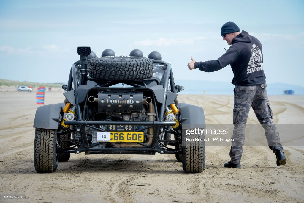 An Atom Nomad off road style vehicle is given the thumbs up to start in the Straightliners 'Top Speed' event at Pendine Sands, Wales, where riders and drivers compete for top speeds over a measured mile on the beach.