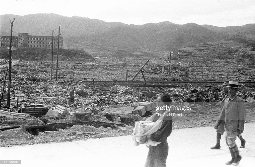 An atomic bomb surviver walks with holding bones of her parents who were killed by Nagasaki Atomic bomb in August 1945 in Nagasaki, Japan. The world's first atomic bomb was dropped on Hiroshima on August 6, 1945 by the United States at the end of World War II, killing an estimated 70,000 people instantly. Three days later another atomic bomb was dropped on Nagasaki. With the effects of radiation, many thousands more dying over the following years and the number of the victims are thought to be approximately 340,000 people.