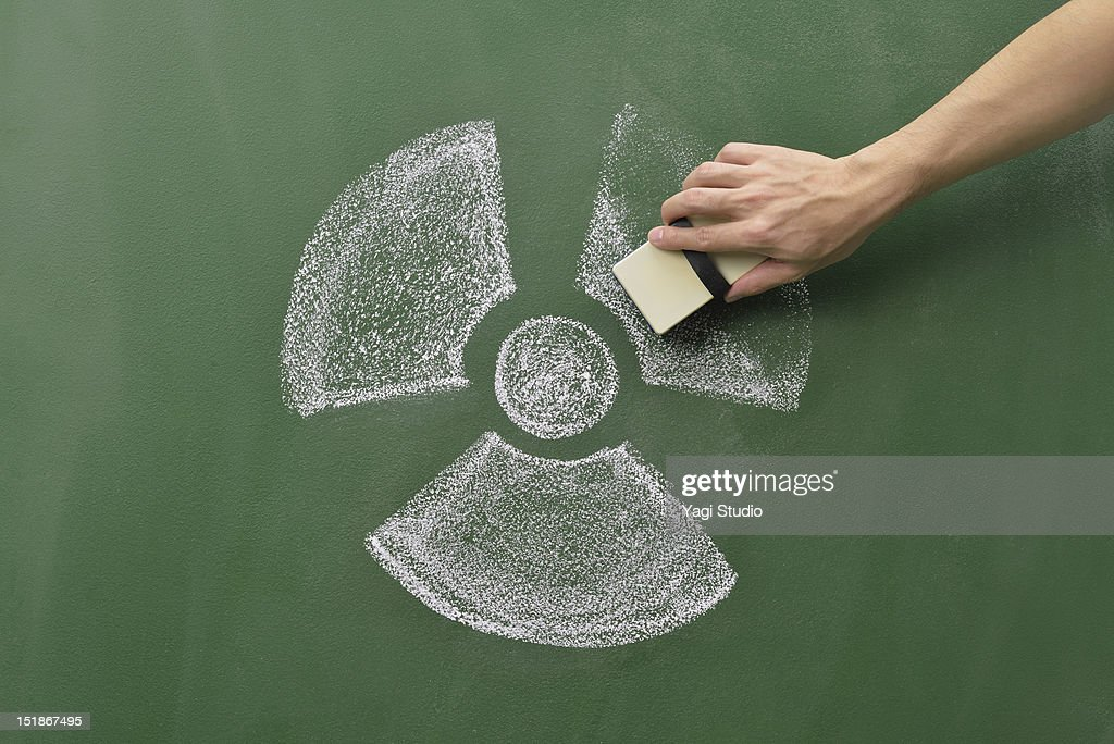 An atomic energy mark and hand delete mark. : Stock Photo