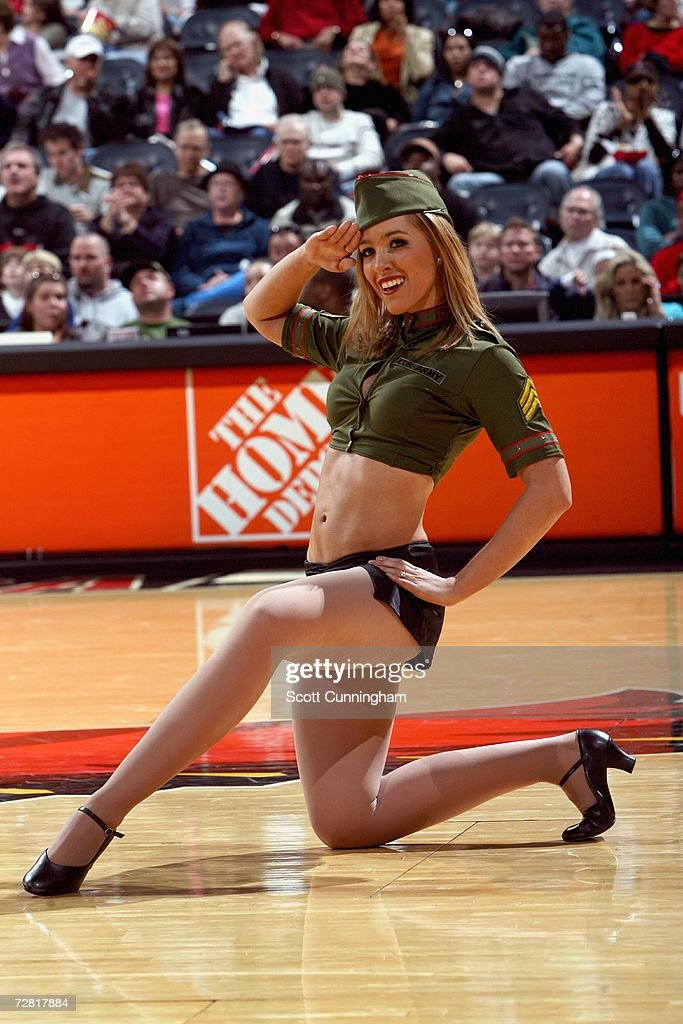 An ATown Dancer performs during the NBA game between the Atlanta Hawks and the Orlando Magic at Philips Arena on November 5 2006 in Atlanta Georgia...