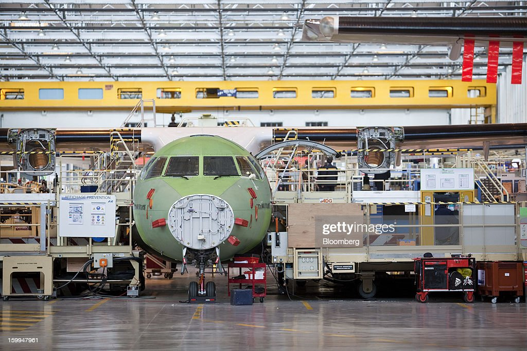 An ATR 72 turboprop aircraft, manufactured by Avions de Transport Regional (ATR), stands under construction at the company's production facility in Colomiers, France, on Wednesday, Jan. 23, 2013. ATR, the world's largest maker of turbo-propeller airliners, reported record profit for 2012, even as it fell short of its shipment target amid production delays. Photographer: Balint Porneczi/Bloomberg via Getty Images