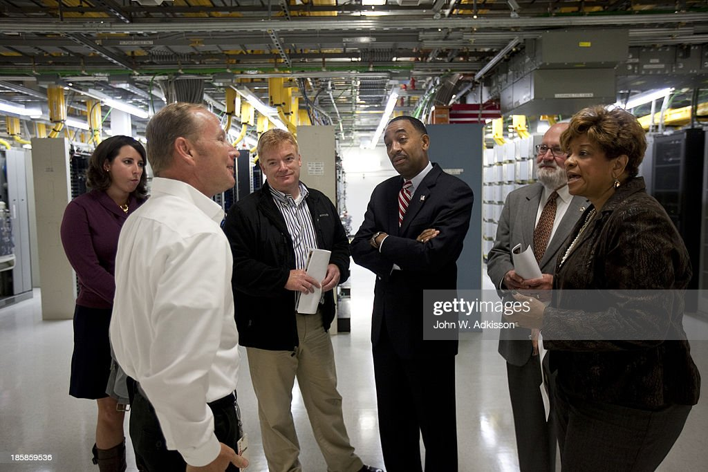 An AT&T employee (Left) gives a tour of the mobile telephone switching office to local officials on October 25, 2012 in Charlotte, North Carolina. The center handles wireless AT&T traffic from the western part of North Carolina.