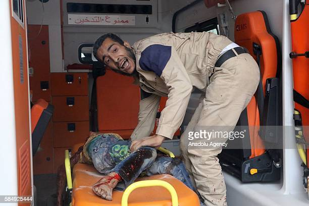 An attack victim boy is being hospitaliz after Assad forces hit residential areas in Ansari neighborhood of Aleppo Syria on July 31 2016 Several...