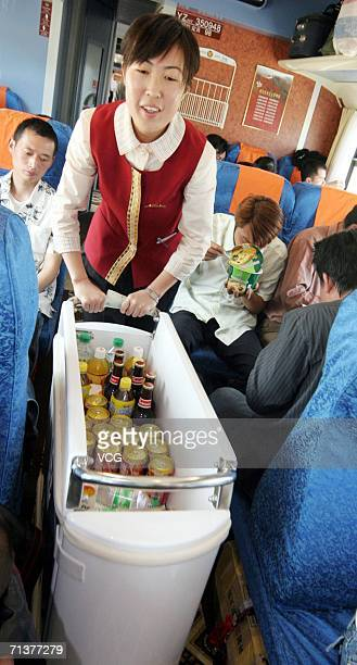 An attendant cserves customers on the first train from Lhasa to Beijing on July 4 in Lhasa Tibetan Autonomous China