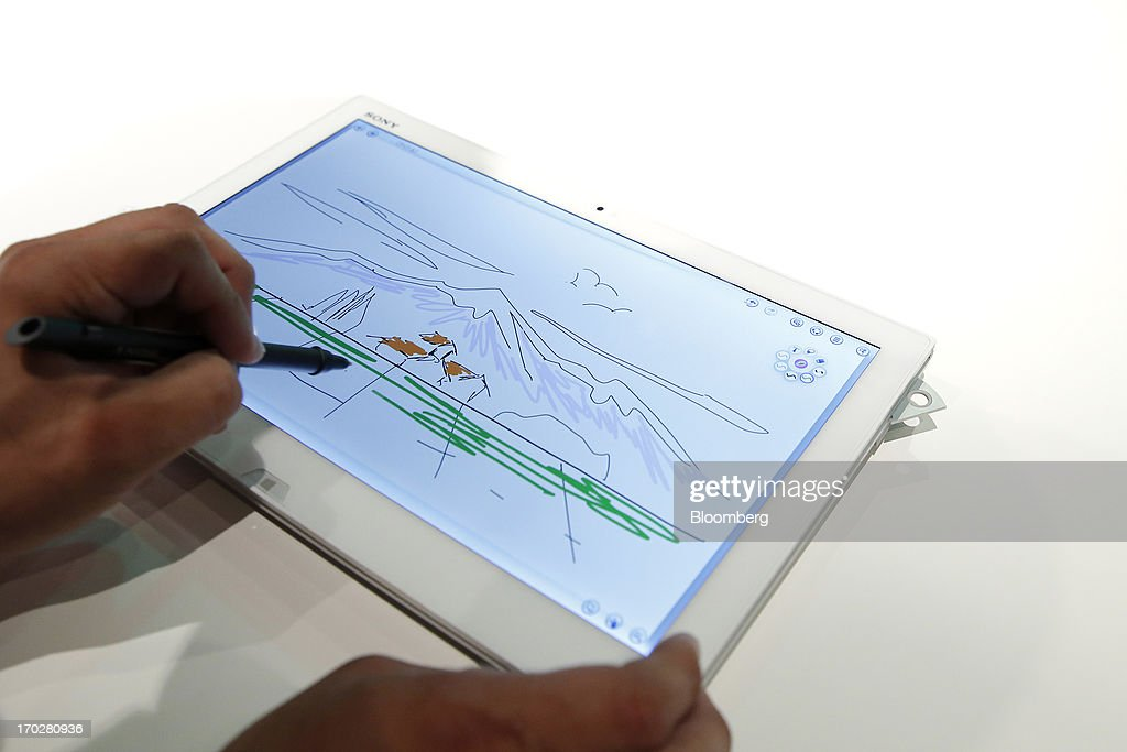 An attendant demonstrates the Sony Corp. Vaio Duo Ultrabook laptop computer with a Sony Digitizer Stylus digital pen during a product launch in Tokyo, Japan, on Monday, June 10, 2013. Sony Corp. is Japan's biggest consumer-electronics exporter. Photographer: Kiyoshi Ota/Bloomberg via Getty Images