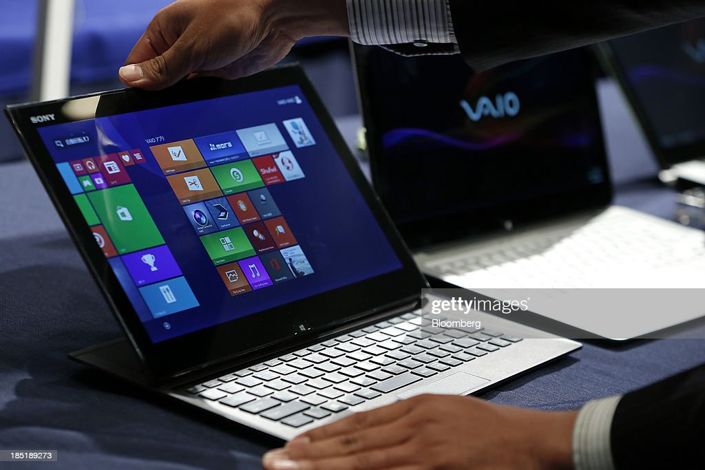 An attendant displays a Sony Corp. Vaio Duo laptop computer, running Microsoft Corp.'s Windows 8.1 operating system, during a launch event for the operating system in Tokyo, Japan, on Friday, Oct. 18, 2013. Microsoft Chief Executive Officer Steve Ballmer, who will be retiring within a year, said the company is still working to make sure that the personal computer remains relevant as 'the device of choice.' Photographer: Kiyoshi Ota/Bloomberg via Getty Images