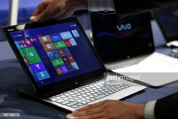 An attendant displays a Sony Corp Vaio Duo laptop computer running Microsoft Corp's Windows 81 operating system during a launch event for the...