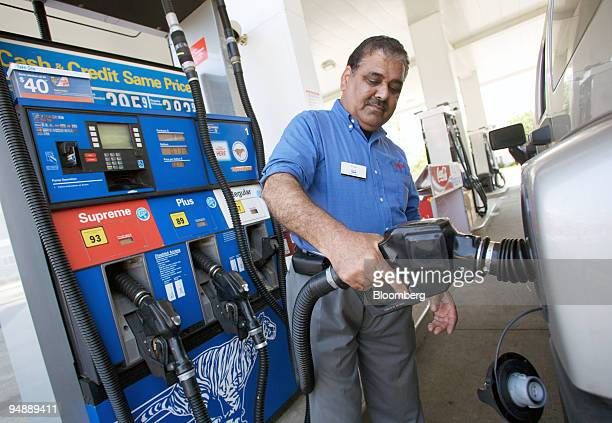 An attendant pumps gas at an Exxon Mobil station in Point Pleasant New Jersey US on Sunday June 1 2008 New Jersey's beaches may be among the few...
