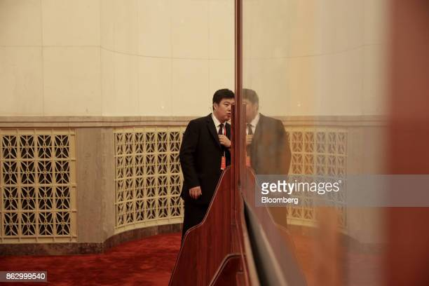 An attendant stands in a hallway in the Great Hall of the People during the 19th National Congress of the Communist Party of China in Beijing China...